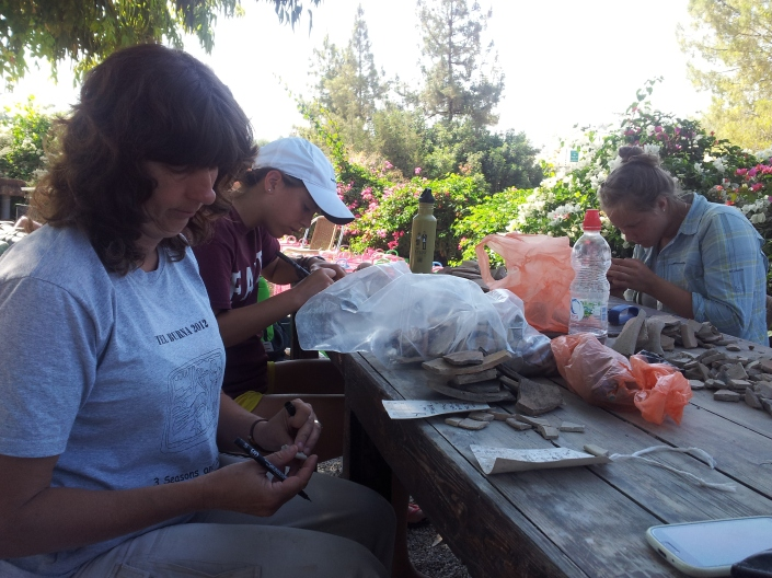 Sheila, Marylinne, and KJ writing on pottery