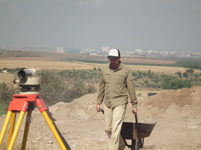 Casey making his way back to the excavation area with Kiryat Gat in the background