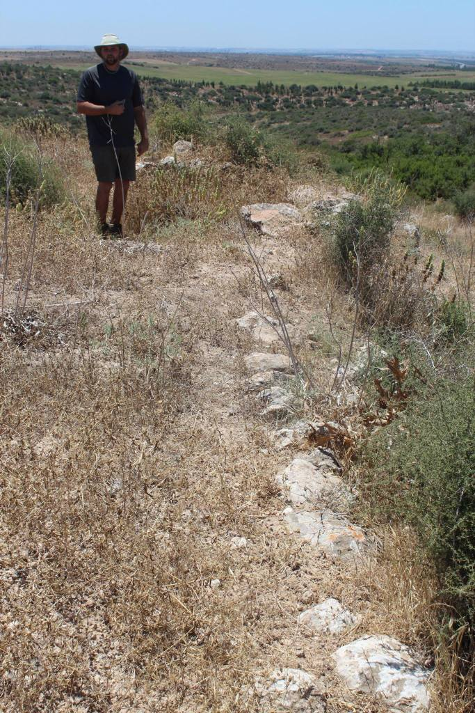Chris on what appears to be Iron II fortification at Khirbet 'Atr