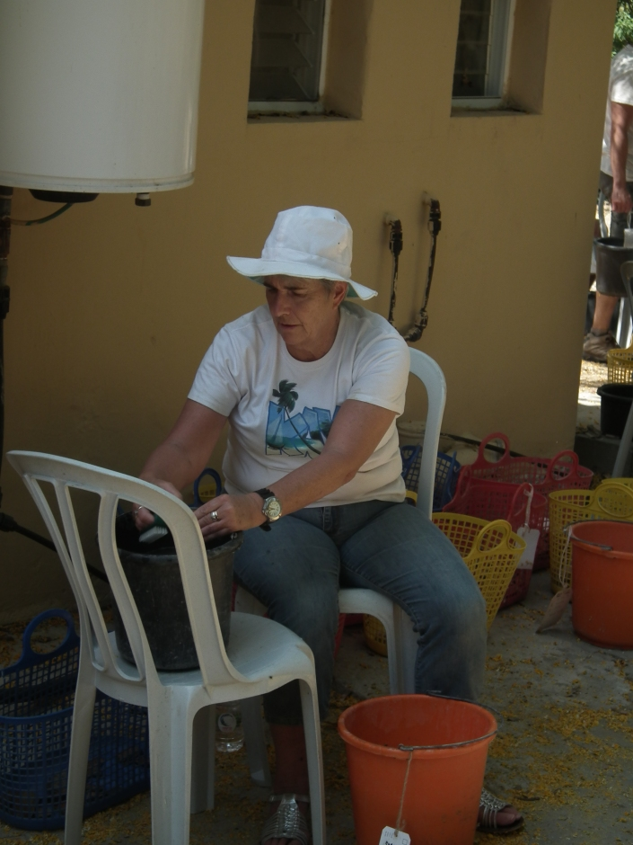 Kay washing some pottery at the kibbutz