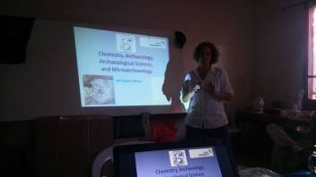 Adi lecturing on microarchaeology