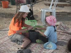 Washing pottery (and each other :)